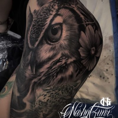 Thigh tattoo featuring black and grey realism owl by Nashy