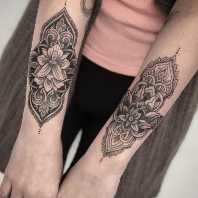 Lotus and mandala forearm tattoos by Phoebe May