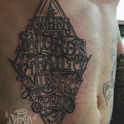 Script tattoo by Yas Vo