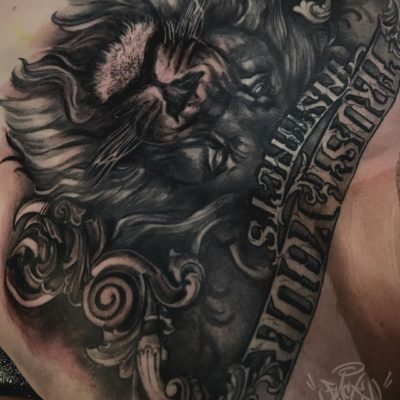 Lion and script chest piece by Yas Vo
