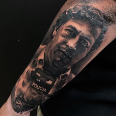 Portrait tattoo in black and grey realism by Cotteez