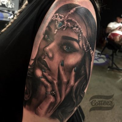 Realism portrait tattoo by Cotteez